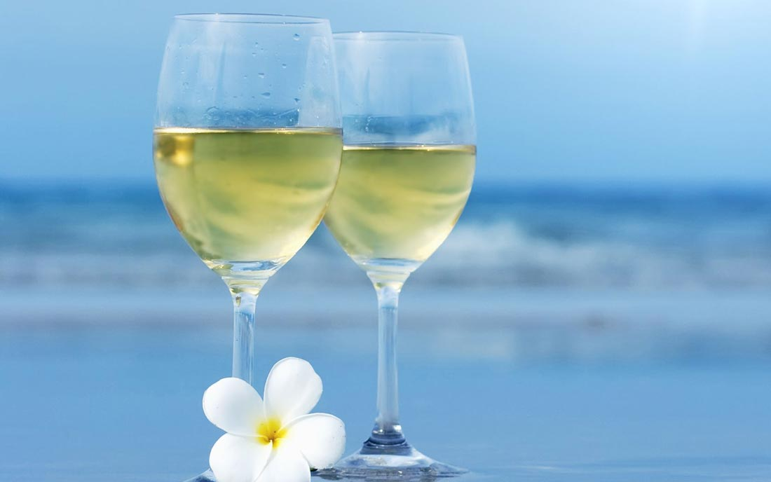 Wine-Glasses-With-White-Flower-Closeup-Near-Sea